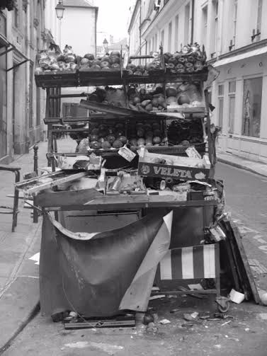 Burned fruit stall in Paris by Eimear Jackson